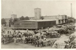 Vintage photo of workers in front of Carr Mill